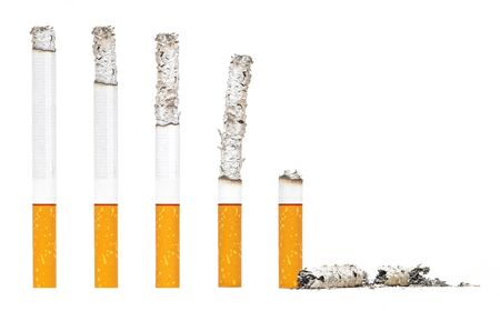 Photo pour Burned Almost Cigarettes Step on iSolated White Background. - image libre de droit