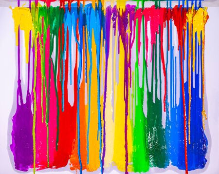 Foto de colorful of screen printing ink are dripping on white background - Imagen libre de derechos