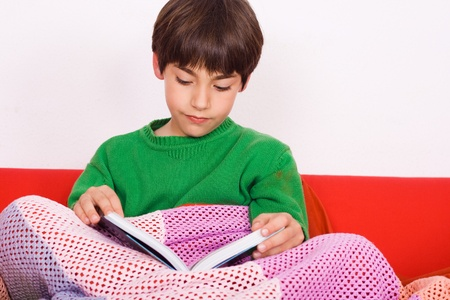 child reading on the couch
