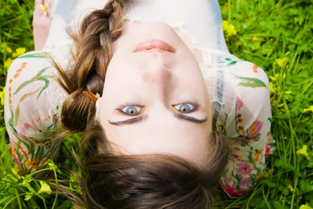 portrait of beautiful young hippie and staring at the camera upside down
