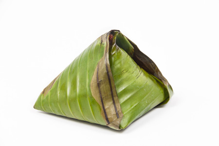 Single pack of simple and authentic nasi lemak wrapped in banana leaf.