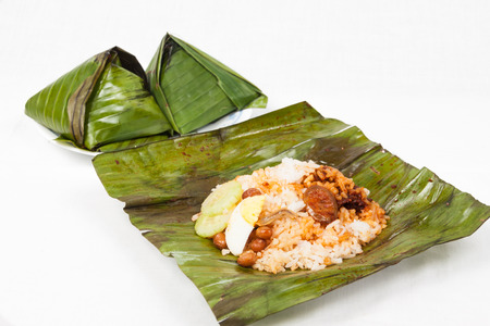 Simple and authentic nasi lemak wrapped in banana leaf.