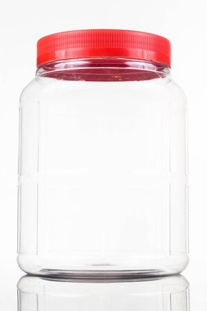 Translucent plastic PVC jar with red cover isolated in white