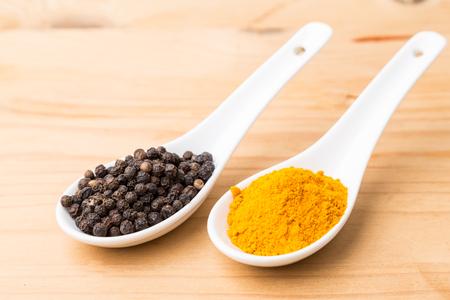 Foto für Turmeric roots and black pepper combination enhances bioavailability of curcumin absorption in body - Lizenzfreies Bild