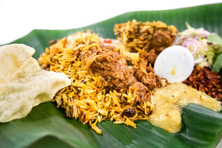 Delicious nasi briyani with lamb mutton served on banana leaf plate, popular food in Malaysia