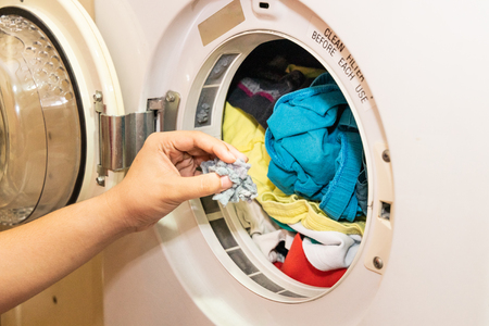 Handful of lint trapped in filter of laundry dryer clothes machine after drying