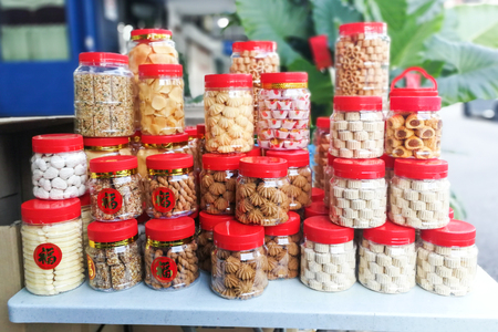 Photo pour Assorted Chinese New Year cookies with Chinese character Prosperous for sale - image libre de droit
