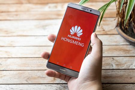 KUALA LUMPUR, MALAYSIA, MAY 25, 2019: Person holding Huawei Mate phone with Hongmeng OS symbol. U.S. companies began  to curb sales to Chinese telecom Huawei