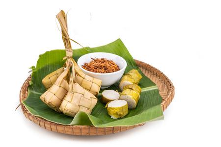 Photo for Ketupat, lemang, served with serunding, popular Malay delicacies during Hari Raya celebration in Malaysia - Royalty Free Image