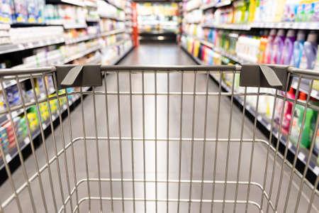 Foto für Shopping trolley cart moving in supermarket with motion blur aisle background - Lizenzfreies Bild