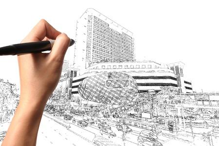 Foto de Hand of Business Man Draw Modern building and Cityscape  - Imagen libre de derechos