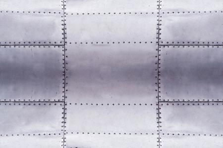 Photo pour detail of old grunge piece of metal plate with bolts, aluminum surface background - image libre de droit