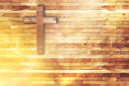 Photo for wood cross on wooden background in church with ray of light from below - Royalty Free Image