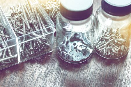 Photo pour many screws, nuts and bolts in bottle for home use background - image libre de droit