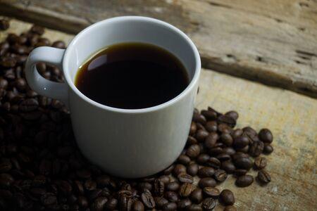Photo pour Coffee beans and espresso on wood background - image libre de droit