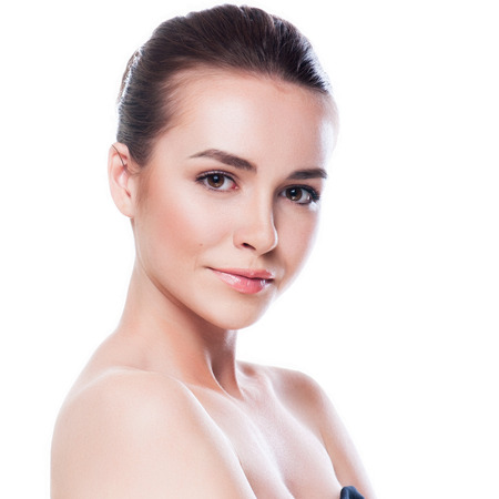 Beautiful face of young adult woman with clean fresh skin - isolated on whiteの写真素材