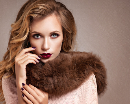 Beautiful Woman in Luxury Fur Coatの写真素材