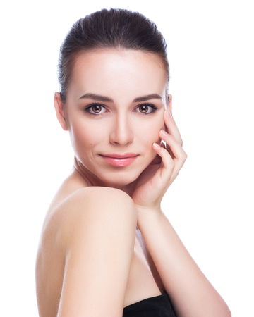 Photo pour Beautiful Young Woman Touching Her Face.Fresh Healthy Skin.Isolated on White - image libre de droit