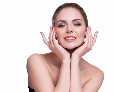 Photo pour Beautiful Young Woman Touching Her Face.Fresh Healthy Skin.Isolated on White. - image libre de droit