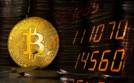 Photo pour Close-up bitcoin on the background of coins of baht. Stocks Exchange Market Graph Concept. - image libre de droit