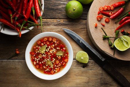 Thai fish Sauce in a cup on wood background