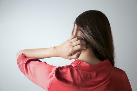 Photo pour Woman scratching her neck - image libre de droit