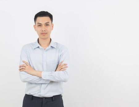 Photo pour Young handsome asian business man looking to camera with arms crossed isolated on white background. - image libre de droit