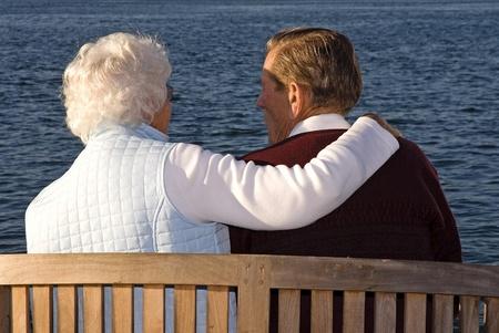 Caring couple sitting and enjoying the sunset