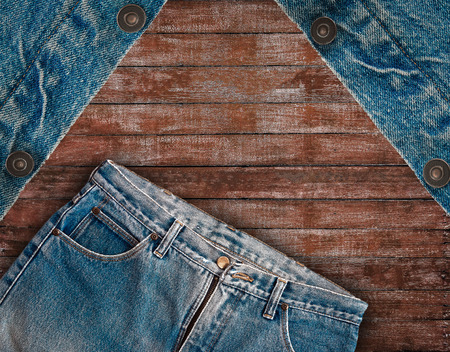 vintage denim jean put on wooden background, denim texture, denim textile, denim background.