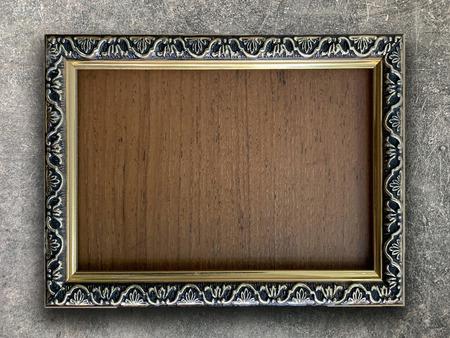 Photo pour Close up old rustic picture frame on cement wall texture background - image libre de droit