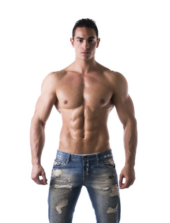 Frontal shot of shirtless muscular young man in jeans, relaxed pose, isolated on white