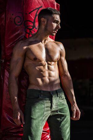 Foto de Handsome Muscular Shirtless Hunk Man Outdoor in City Setting. Showing Healthy Body While Looking away - Imagen libre de derechos