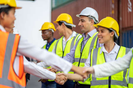 Photo for Construction Engineering Team are Handshake Together After Dealing Their Project Successful, Finishing successful meeting. - Royalty Free Image