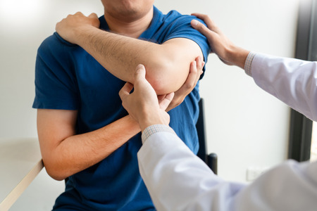 Photo pour Physiotherapist working concept, Doctor and patient suffering or Chiropractor examining from shoulder pain in clinic medical office - image libre de droit
