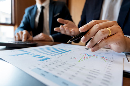 Photo pour Business Corporate team brainstorming, Planning Strategy having a discussion Analysis investment researching with chart at office his desk documents and saving concept. - image libre de droit