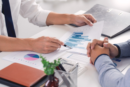 Photo for Business Corporate team brainstorming, Planning Strategy having a discussion Analysis investment researching with chart at office his desk documents and saving concept. - Royalty Free Image