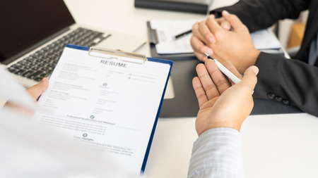 Photo pour Job Interview and hiring concept, Appointment candidate Business man explaining about his profile and answer to Human resources manager sitting at a table opposite in the office - image libre de droit