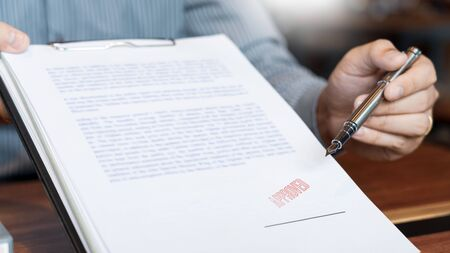 Photo for male point to signing business document for putting signature, fountain pen and approved stamped on a document, certificate contract agreement lawyer hand concept - Royalty Free Image