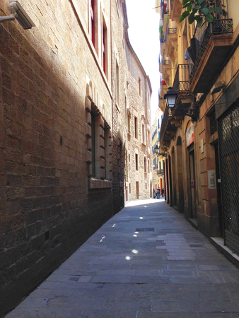 One of the narrow streets in El Gotic district of Barcelona