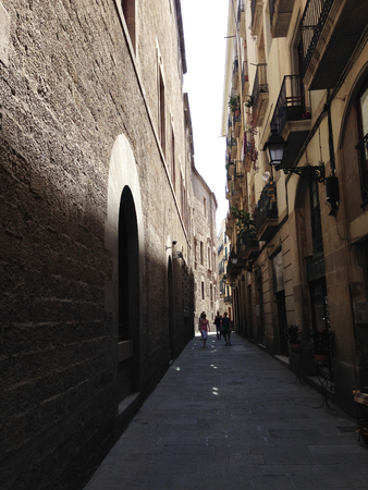 Traditional, narrow street in El Gotic district of Bacelona