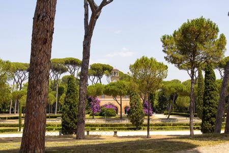 View of Lavish Borghese villa designed by Ponzio & Vasanzio, with formally landscaped gardens & a lake.