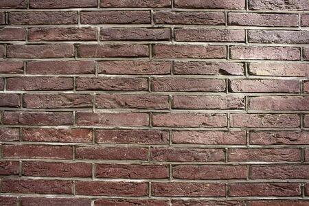 Foto de Close up view of red / brown brick wall. - Imagen libre de derechos
