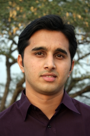 A portrait of a young Indian man.