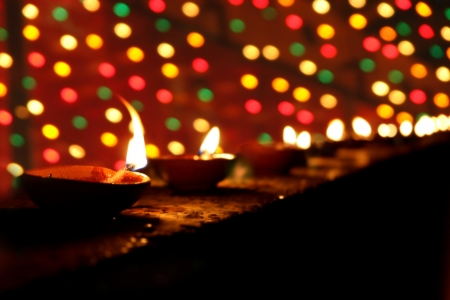 Beautiful clay lamps lit in a line on the occasion of Diwali festival in India