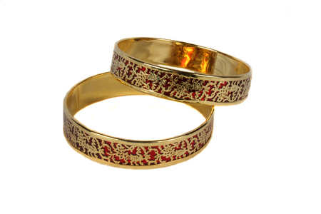 Photo pour Traditional Indian bangles with an intricate design in gold on crimson color. - image libre de droit