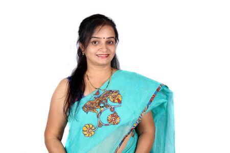 Foto de A beautiful middle aged Smiling Indian woman, on white studio background. - Imagen libre de derechos