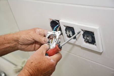 Photo for Electrican repair and installing socket, outlet plug - Royalty Free Image