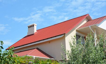 Photo pour New house roofing construction with metal roof and waterproofing in problem roof areas exterior. - image libre de droit