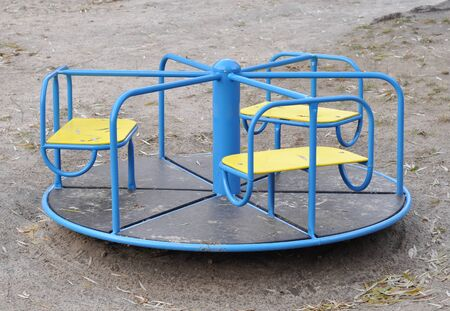 Photo for Playground roundabout (or merry-go-round) at children playground - Royalty Free Image