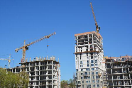 Photo pour Cranes Construction Concept Photo. Cityscape with Cranes Construction  - image libre de droit